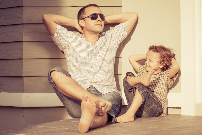 boy and dad in sun